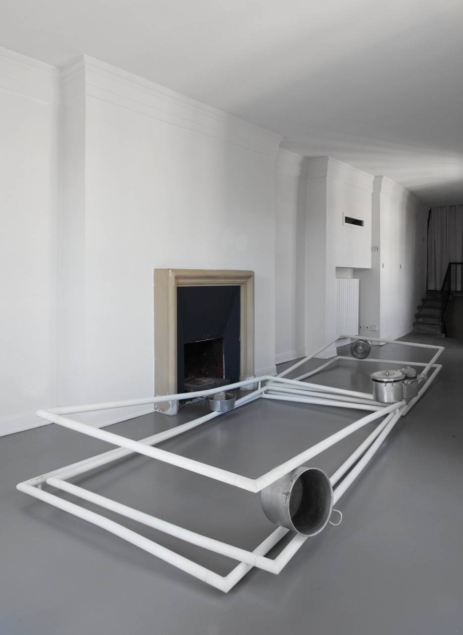 2012, painted steel, cooking pots, concrete, newspaper, approx 45.5 x 137 x 440 cm