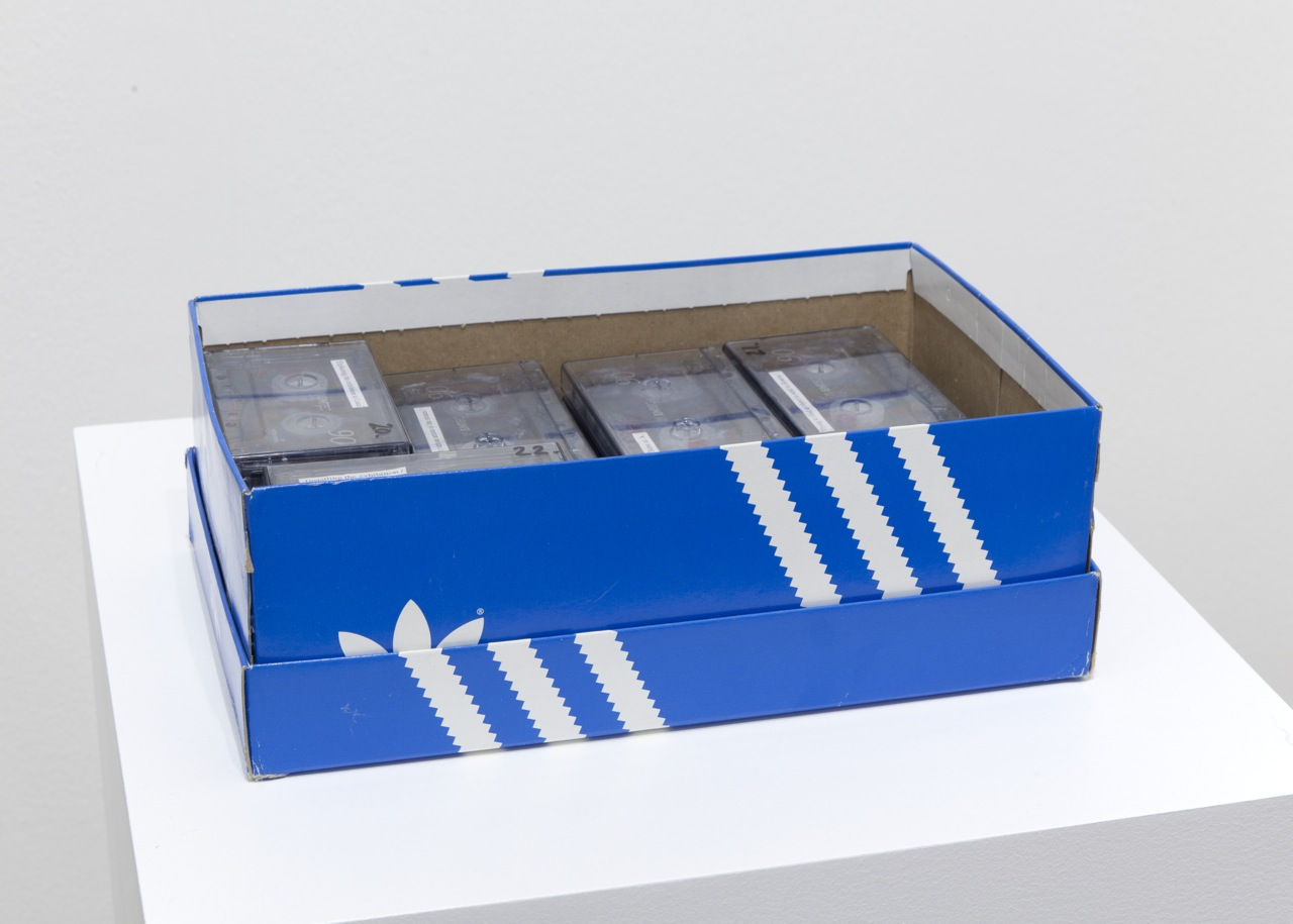 shoe box, 26 audio tapes with labels, cm 31 x 11 x 19